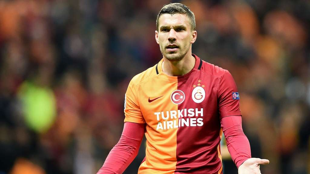 Galatasaray&#39s German forward Lukas Podolski reacts during the UEFA Champions League Group C football match between Galatasaray AS and FC Astana at the Turk Telekom Arena in Istanbul on December 8, 2015. AFP PHOTO / OZAN KOSE
