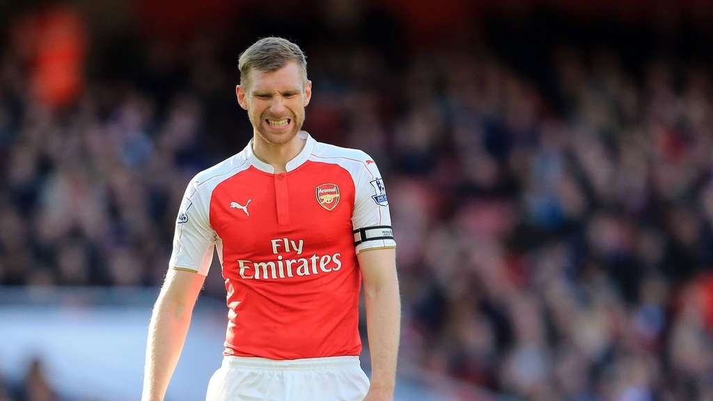 Arsenal s Per Mertesacker looks on dejected during the Barclays Premier League match at the Emirates