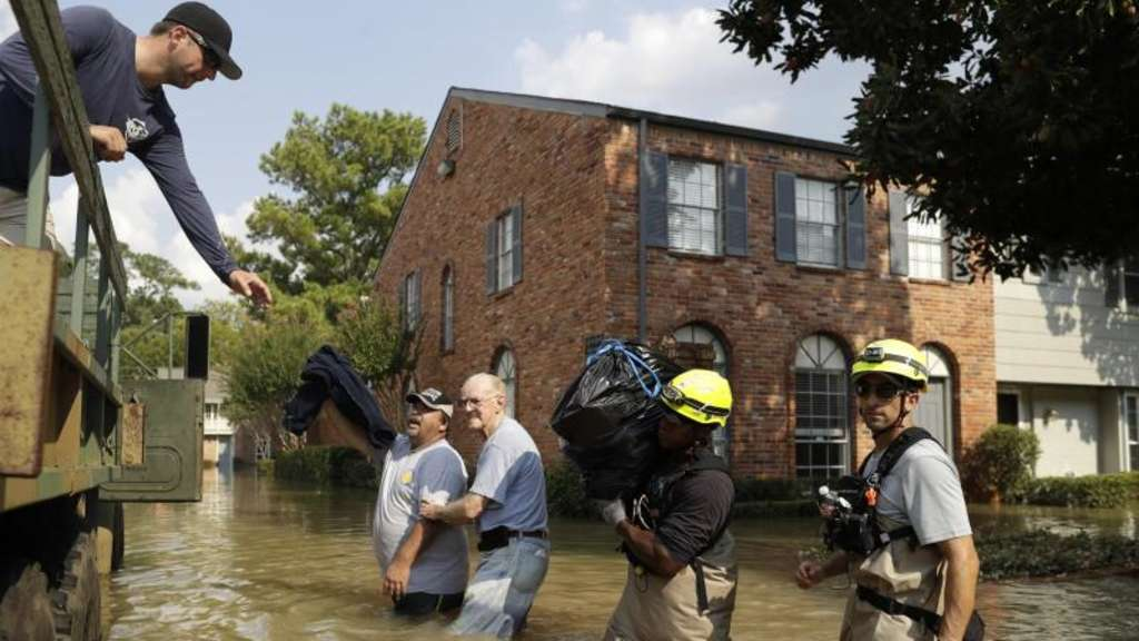 "In den USA hat der Tropensturm ""Harvey"" Schäden in Milliardenhöhe angerichtet. Foto: Gregory Bull/AP/dpa"