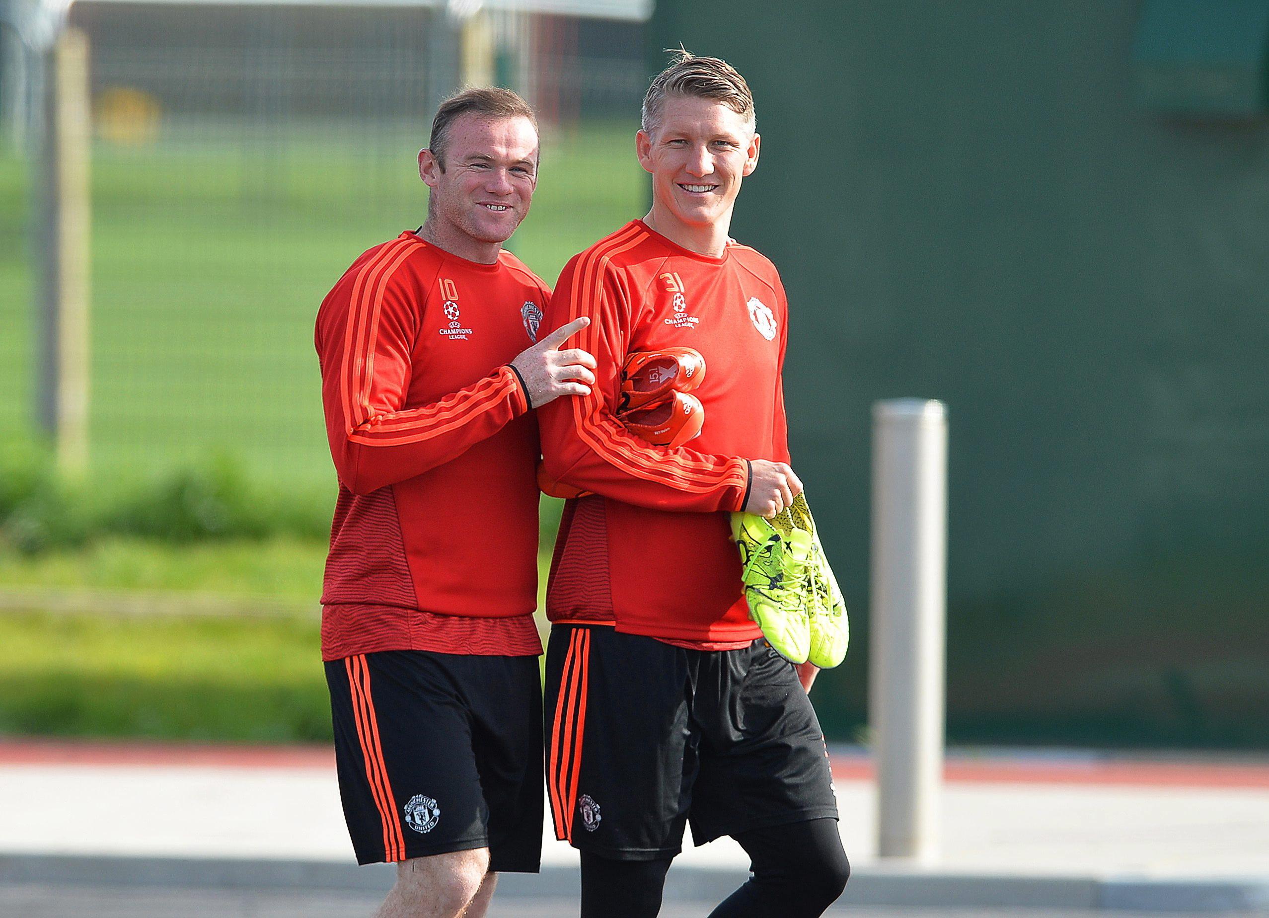 Wayne Rooney (l.) und Bastian Schweinsteiger.