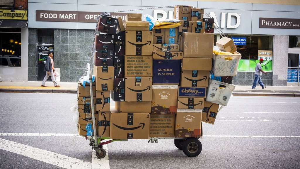 Package delivery in New York An unattended handcart laden with packages from Amazon among others in